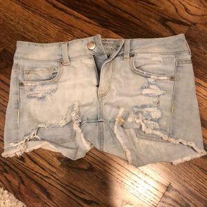 Distressed light wash denim shorts